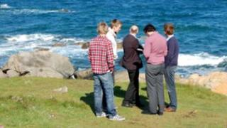 Students on Guernsey's coast
