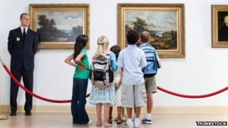 Security guard and children in a museum