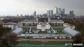 Workmen construct grandstands of the Olympic show-jumping arena in Greenwich Park