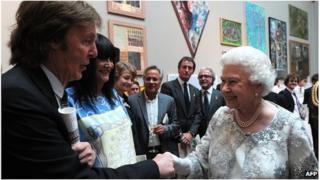 The Queen meeting Sir Paul McCartney