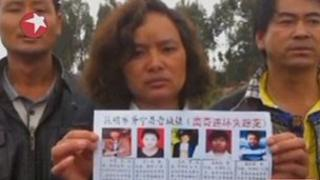 China killings - woman holds up poster