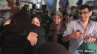 Relatives of abducted Lebanese Shiite Muslim pilgrims kidnapped in northern Syria embrace each other following news of their release on May 25.