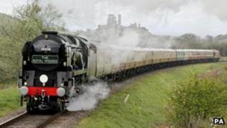 Steam train passes Corfe Castle