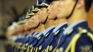 Members of Chinese military honour guard stand in a line at the Great Hall of the People in Beijing, 9 April 2012