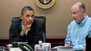 US President Barack Obama discusses the mission to kill Osama Bin Laden with his national security adviser Tom Donilon at the White House 1 May 2011