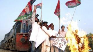 Protesters stop a train in Uttar Pradesh on 31 May 2012