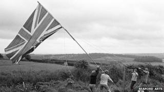 Hoisting the Jubilee flag, Harepath South Harepath, Beaford, June 1977 - Photograph by James Ravilious © Beaford Arts digitally scanned from a Beaford Archive negative
