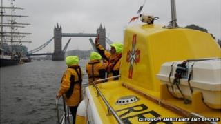 Guernsey marine ambulance Flying Christine III heading towards Tower Bridge as part of the Diamond Jubilee Pageant
