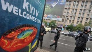Riot police next to a Euro 2012 poster at an opposition demonstration in Kiev on 5/6/2012