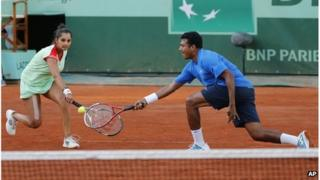 "India's Sania Mirza, left, and Mahesh Bhupathi play Poland's Klaudia Jans-Ignacik and Mexico""s Santiago Gonzalez in their mixed doubles final match at the French Open in Paris, Thursday, 7 June, 2012."