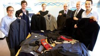 Alex Ogilvie, Dan Allman, Rebecca Stannard, Peter Murley, Ian Murphy and Matthew Morel of Hawksford with a selection of the donated suits
