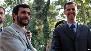 Iranian President Ahmadinejad and Syrian President Assad at a welcoming ceremony in Tehran in August 2005.