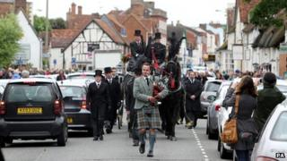 A lone piper leads the funeral procession of Bee Gee Robin Gibb