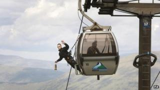 The flame was carried on a gondola on the Nevis Range