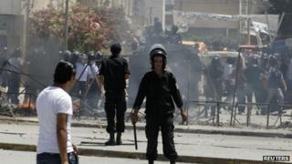 Riot police chase down protesters in Tunisia's capital Tunis on 12 June 2012