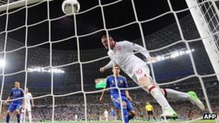 Wayne Rooney heads England's goal against Ukraine