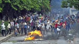 Garment workers throw pieces of bricks during clashes with police in Kanchpur, Dhaka June 16, 2012