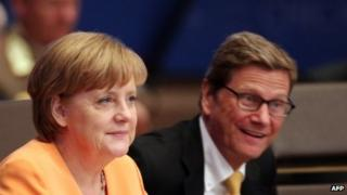 Chancellor Angela Merkel and German foreign Minister Guido Westerwelle at a Nato conference in Chicago in May 2012
