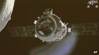 The orbiting Tiangong-1 space lab as seen from the Shenzhou-9 spacecraft, 24 June 2012