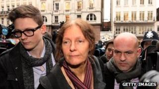 Christine Assange flanked by supporters