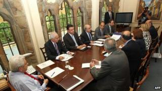 Cypriot President Demetris Christofias (left) presides over a meeting of party leaders in Nicosia, 26 June