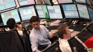 Traders on Frankfurt stock exchange - file pic
