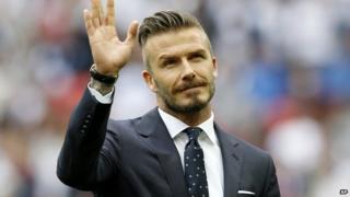 David Beckham waving to crowds