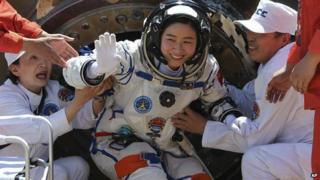 Liu Yang emerges from the return capsule