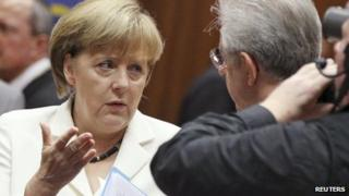 Germany Chancellor Angela Merkel talks to Italy's Prime Minister Mario Monti