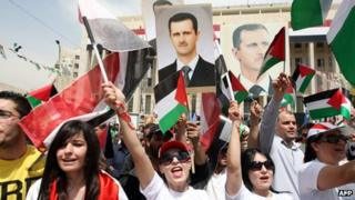 Supporters of President Bashar al-Assad attend a demonstration on the anniversary of the founding of the Baath Party in Damascus (7 April 2012)