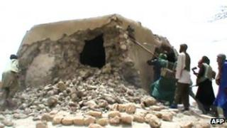 A still from a video shows Islamist militants destroying an ancient shrine in Timbuktu on July 1