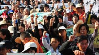Wukan villagers protesting over illegal land grabs and the death of a local leader, 19 December 2011