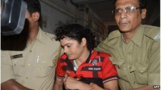 Police escort Former Indian athlete Pinki Pramanik (C) to the Barasat District court in Barasat around 35 Km north of Kolkata on June 15 2012