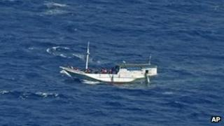 Indonesia's National Search and Rescue Agency released this photo of a wooden boat believed to have up to 180 people
