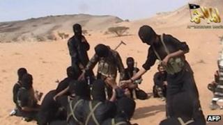 A screen shot of a video posted on the Internet on October 6, 2010 shows militants from Al-Qaeda in the Arabian Peninsula.