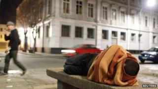 A homeless man sleeps on a cement bench in the downtown of Valparaiso, about 121 km (75 miles) northwest of Santiago, 7 July 2012.