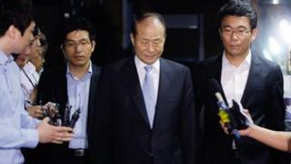Lee Sang-deuk, South Korean President Lee Myung-bak's elder brother, pictured in the centre, is escorted by investigation officers.