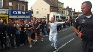 The BBC's Dave Gordon carrying the Olympic flame