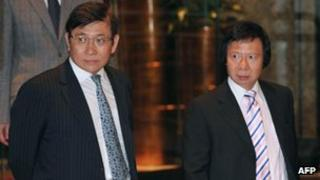 In this file picture taken on 3 April, 2012, Raymond Kwok (L) and Thomas Kwok (R) walk towards a press conference in Hong Kong
