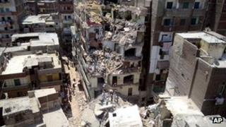 Scene of the collapse of a block of flats in Alexandria, Egypt, on 15 July