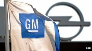 A flag with the logo of US car maker General Motors (GM) flutters in front of an Opel factory