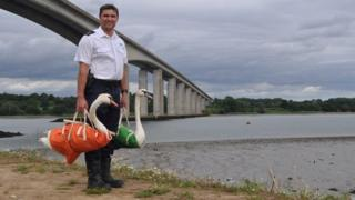 RSPCA inspector Jason Finch with two mute swans