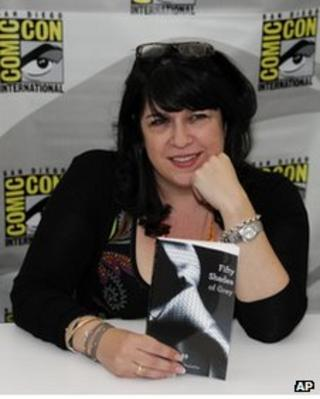 Author E L James poses with her book Fifty Shades of Grey