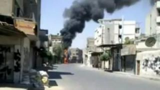 Unverified screengrab from footage uploaded to Youtube alleged to show mortar attacks in Qaboun district in Damascus on 18/07/12
