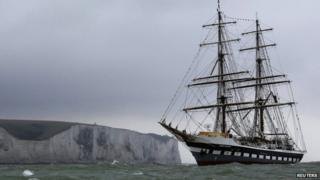 The torch also took a trip on the tall ship Stavros S Niarchos, which struggled into harbour in the inclement weather conditions