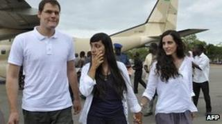 Spaniards Enric Gonyalons and Ainhoa Fernandez Rincon, and Italy's Rossella Urru, arrive at an airport in Ouagadougou, Burkina Faso on Thursday after being freed by kidnappers in Mali