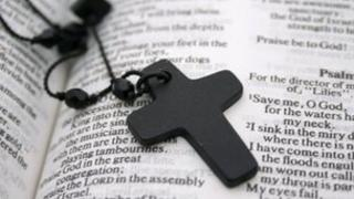 Crucifix on a bible