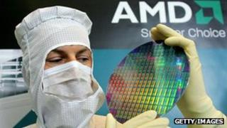 AMD engineer holds up silicon wafer