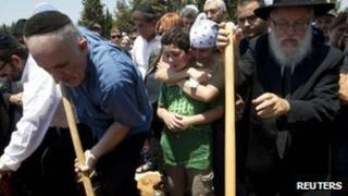 Family and friends mourn as Kochava Shriki, 44, who was killed in an attack in Bulgaria, is buried at a cemetery in Rishon Lezion, near Tel Aviv July 20, 2012