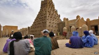 Men outside the Mosque of Sankore in Timbuktu, Mali, in February 2005
